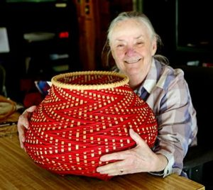 Billie RUth Sudduth poses with a Fibionacci basket that she made