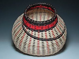 Photo of Billie Ruth Sudduth's Black/Red Signature Basket tilted to show detail