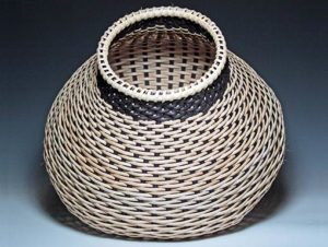 Photo of Billie Ruth Sudduth's Contemporary Cat's Head Basket tilted to see the interior