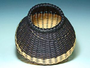 Photo of Billie Ruth Sudduth's Large Signature Basket in Black and Walnut tilted to show detail