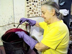 Billie Ruth Sudduth at the walnut dyeing station at her studio